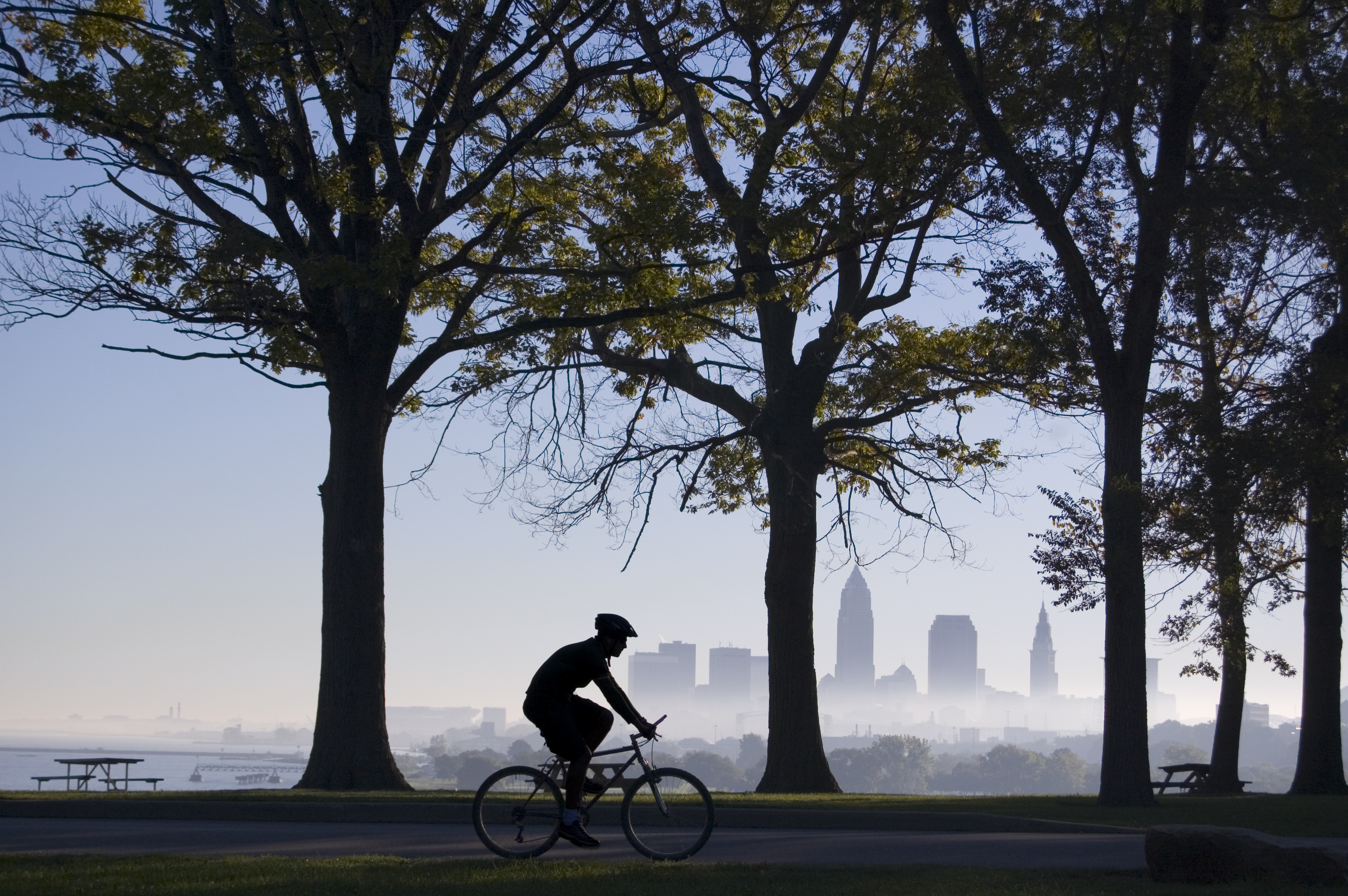GettyImages-116034917 (Biker on Foggy Morning Cleveland in Background)